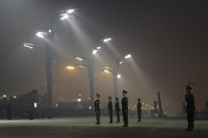 Paramilitary police officers stand guard for the Long Ma performance on a hazy night in Beijing, on Oct. 19, 2014. Reuters/Jason Lee