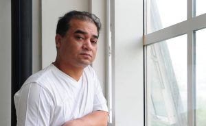 University professor, blogger, and member of the Muslim Uighur minority, Ilham Tohti pauses before a classroom lecture in Beijing on June 12, 2010. Perhaps the top Uighur activist within China, Tohti disappeared into police custody for six weeks last year after Uighur resentment burst forth last July in China's northwest Xinjiang province, in Central Asia, when Uighur rioters savagely attacked Han Chinese in the regional capital Urumqi, leaving nearly 200 people dead and up to 1,700 injured, according to official figures. AFP PHOTO/Frederic J. BROWN / AFP PHOTO / FREDERIC J. BROWN